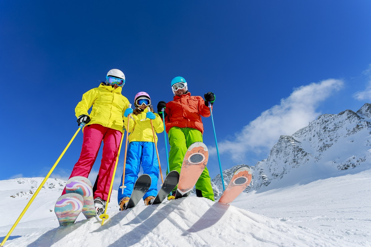 Family in a colorful ski gear