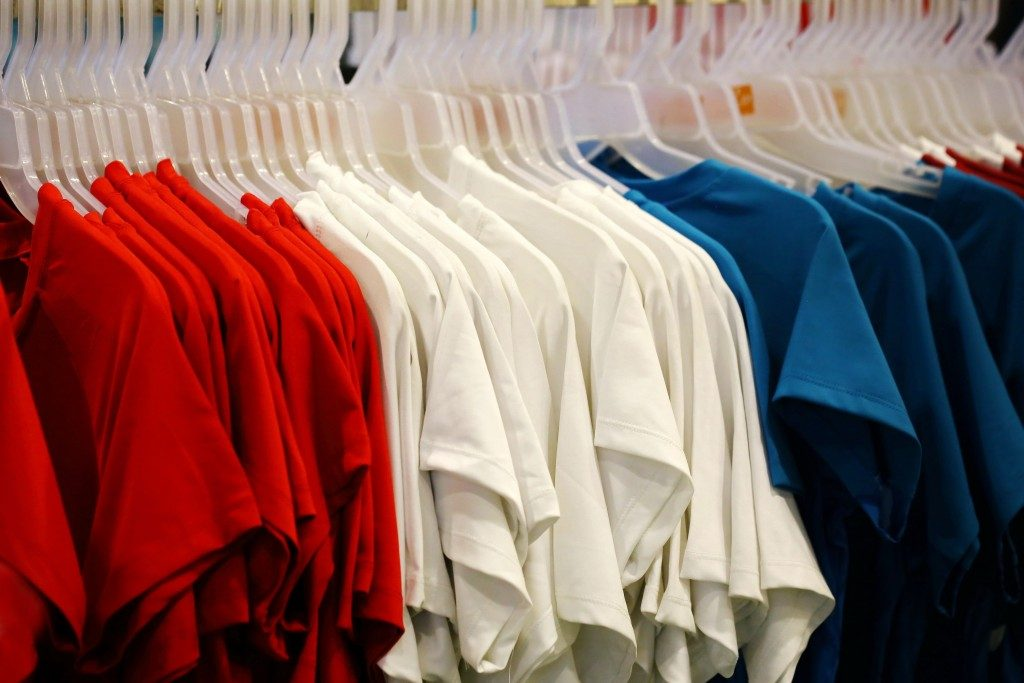 clothes lined up in a store