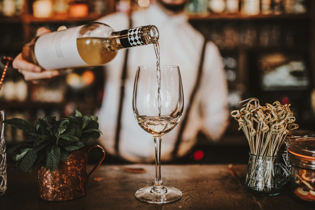 White wine being poured in a wine glass