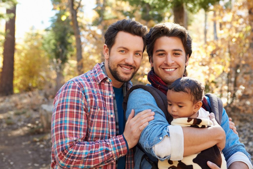 gay couple with their adoptive child