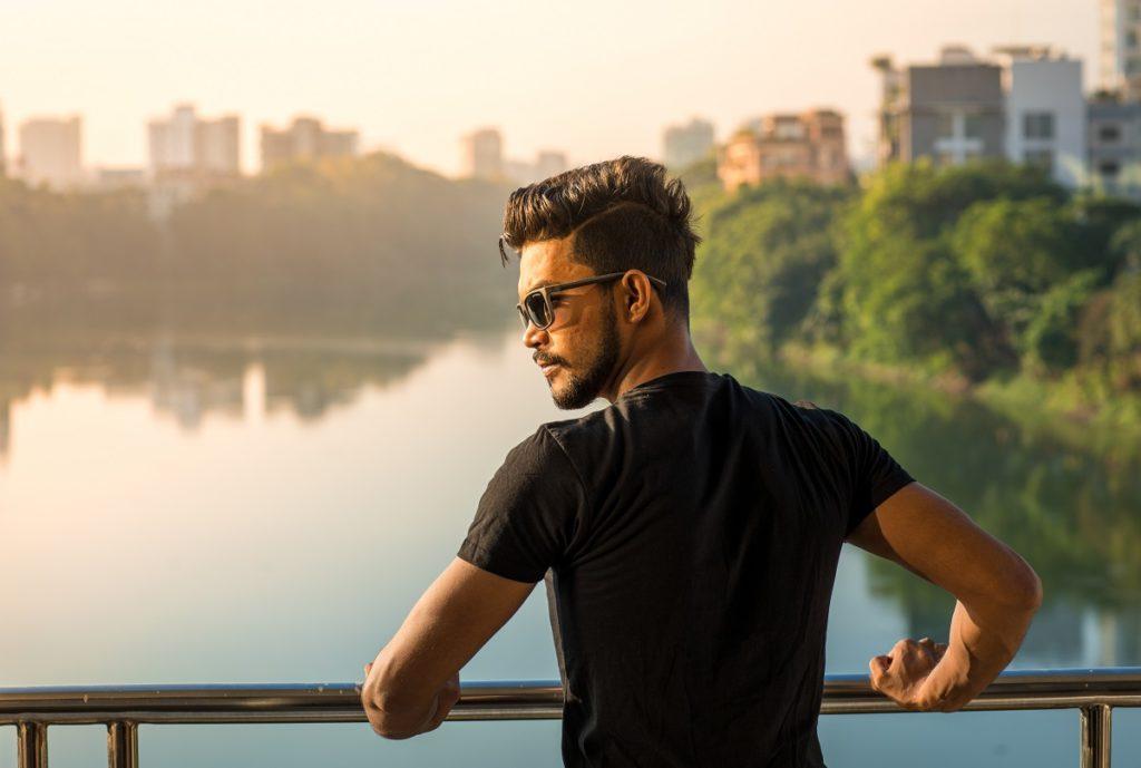 man with nice hair in lake